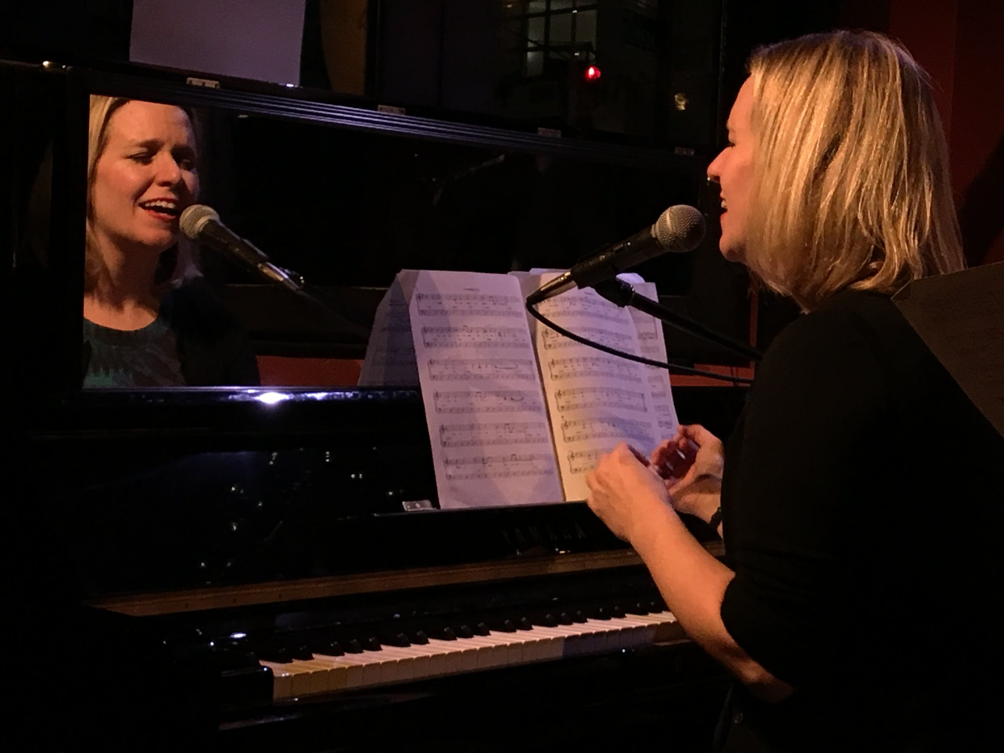 Brenda singing and playing piano