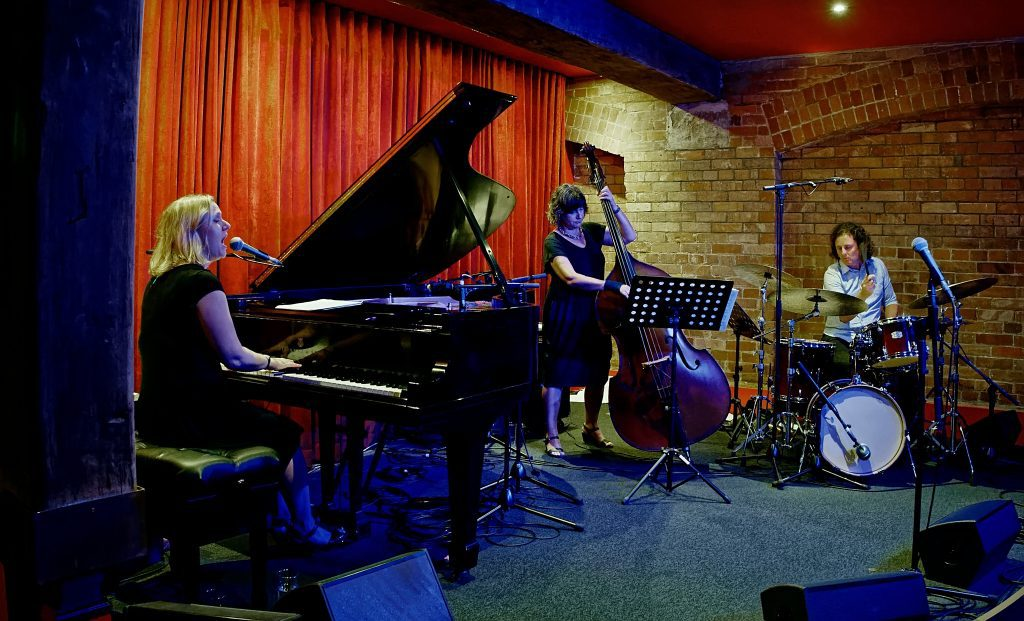 Brenda performing with a jazz trio at a club