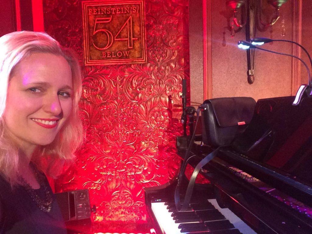 Brenda smiling big at the piano