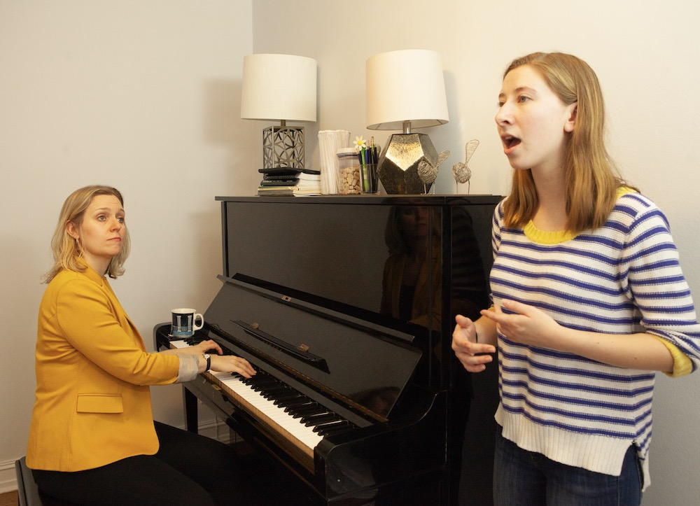 Brenda working with a private lesson playing piano while student sings